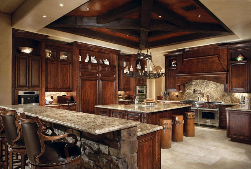 Mediterranean kitchen with juparana arandis granite counters and travertine floor tiles