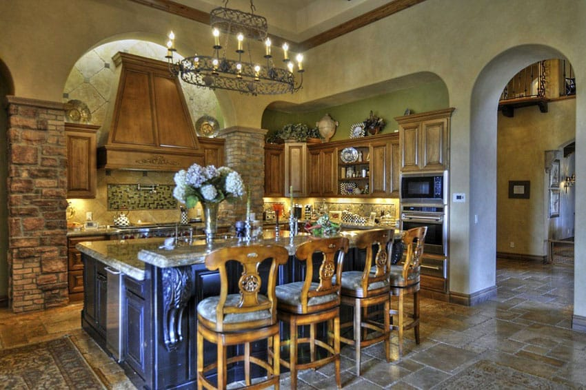 Mediterranean kitchen with medieval style chandelier dining island