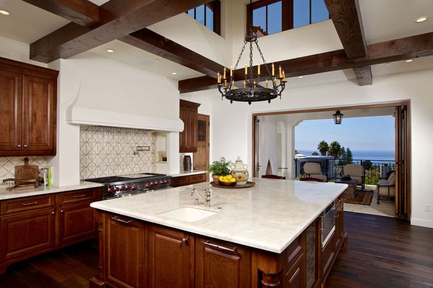 Mediterranean kitchen with ocean view raised ceiling and wood floors