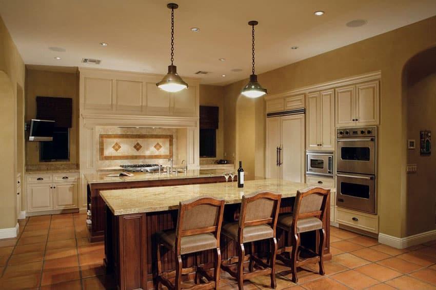 Mediterranean kitchen with terra cotta flooring and bianco romano granite counters