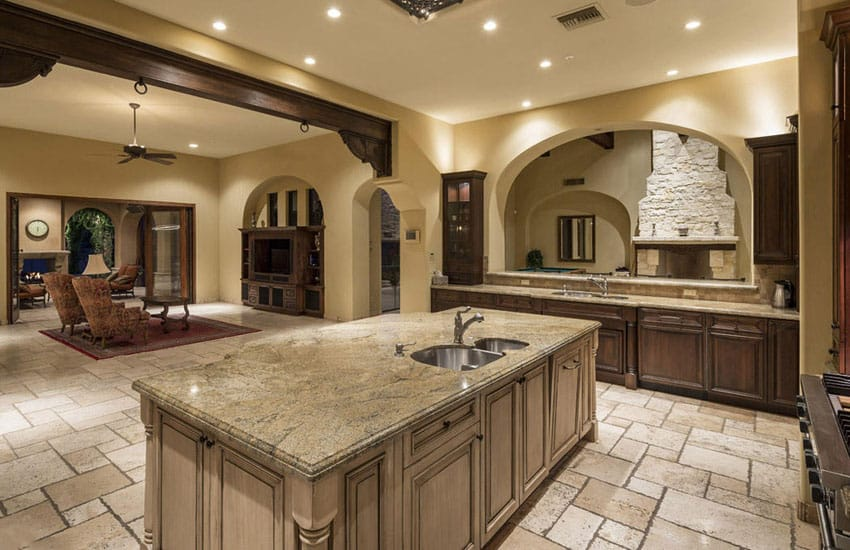 Mediterranean kitchen with typhoon bordeaux granite and travertine tile floors