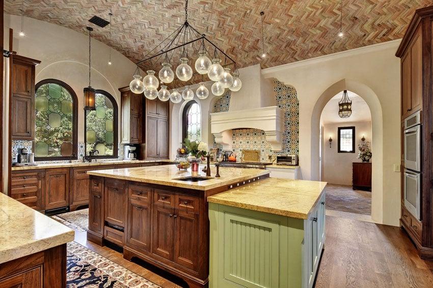 Mediterranean style kitchen with golden riviera granite countertops