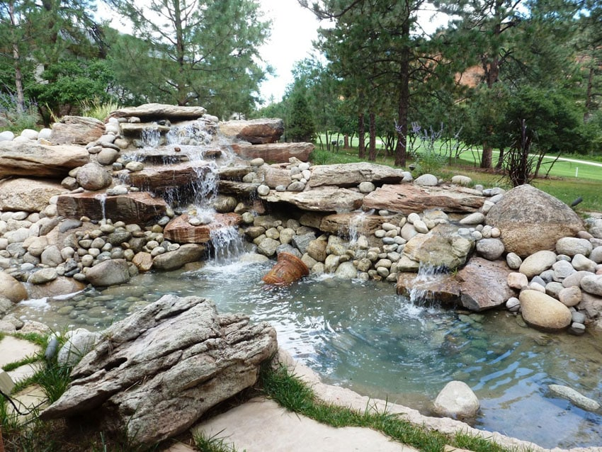 Natural backyard water feature waterfall and pond