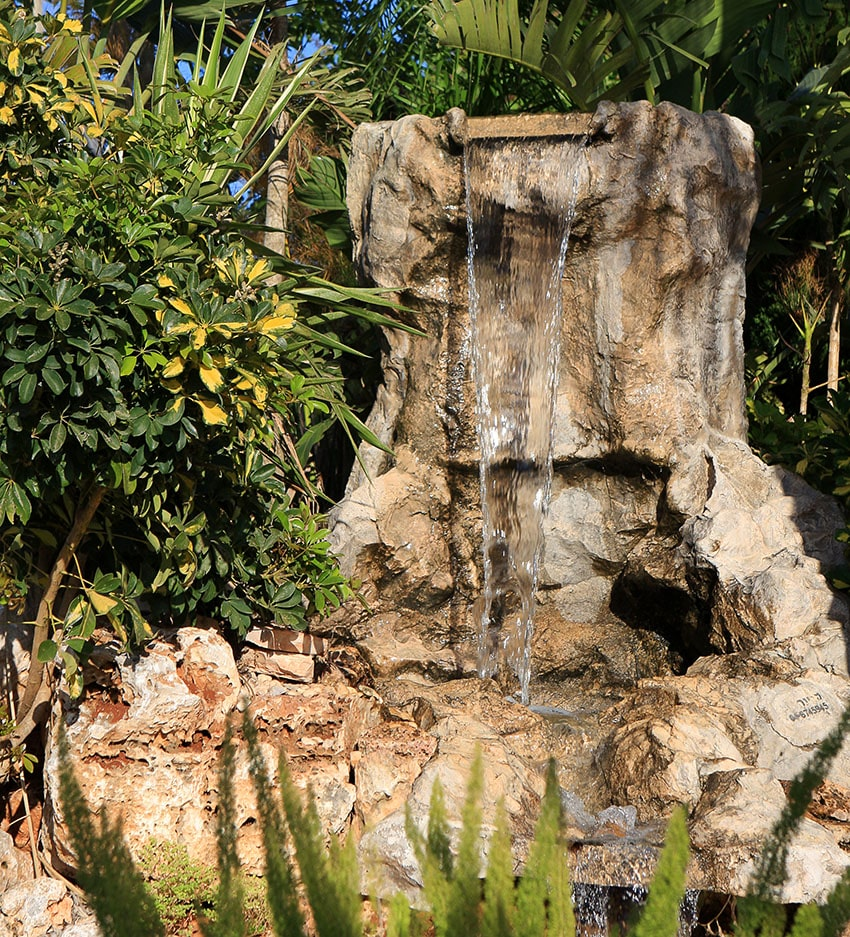 Natural style rock waterfall in garden