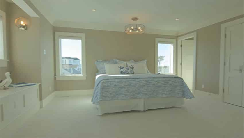 Neutral tone bedroom with window seat