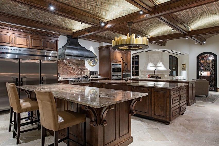 Open layout luxury craftsman kitchen with three islands