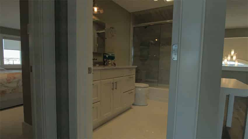 Small guest bathroom with white vanity cabinet