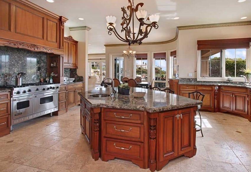 Traditional kitchen with dark granite slab backsplash and travertine floor tiles