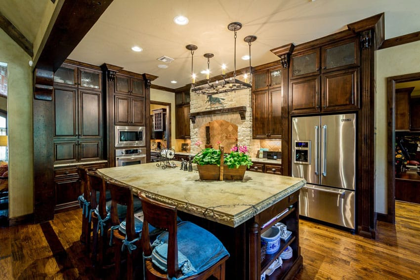 Traditional kitchen with hardwood floors dark cabinets and light stone counters