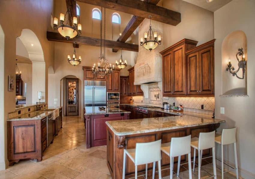 Traditional kitchen with high wood beam ceiling granite counter and tile flooring