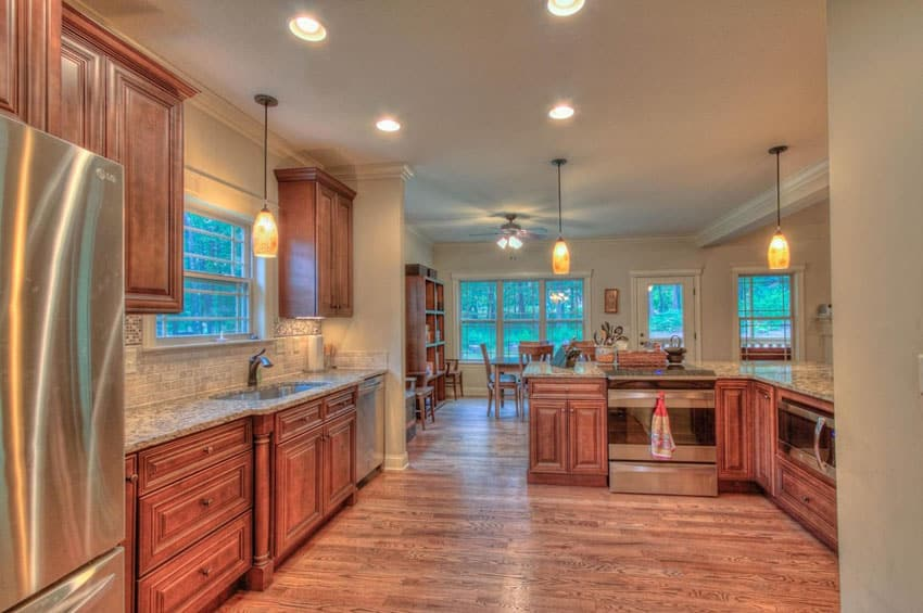 Traditional kitchen with red oak flooring