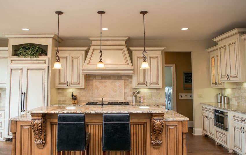 Traditional kitchen with travertine and tile backsplash