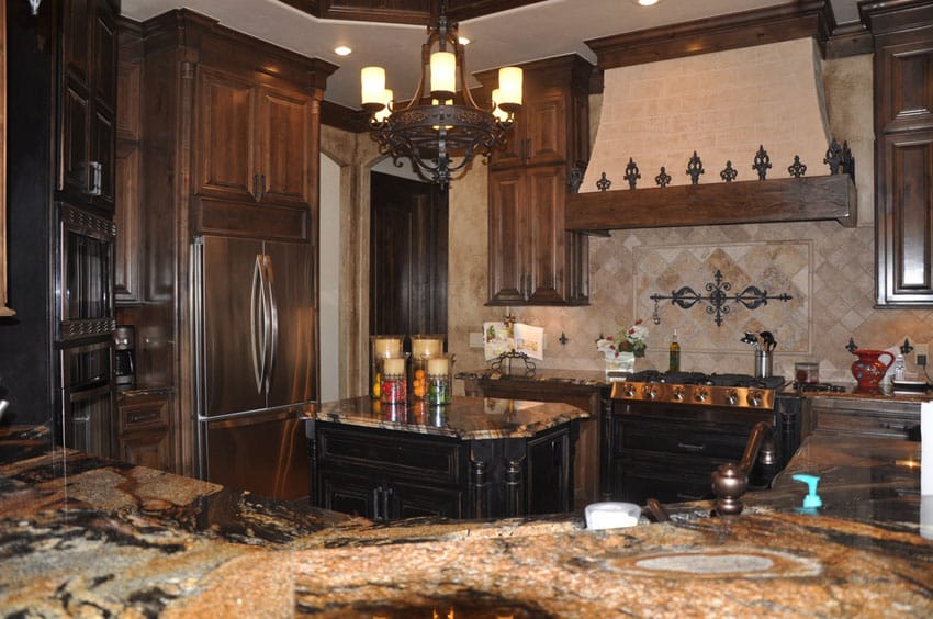 U shaped kitchen with desert dream granite counter and wrought iron chandelier
