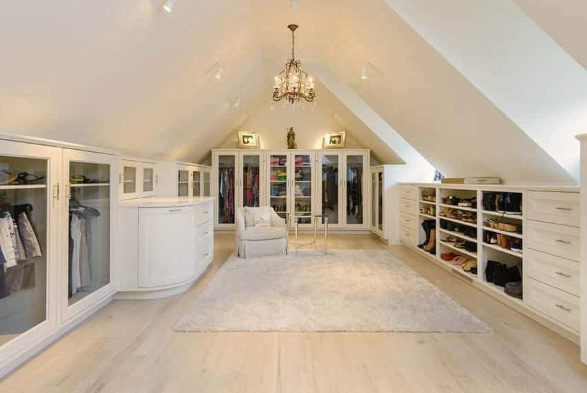 Walk in closet with arched ceiling crystal chandelier and European oak floors
