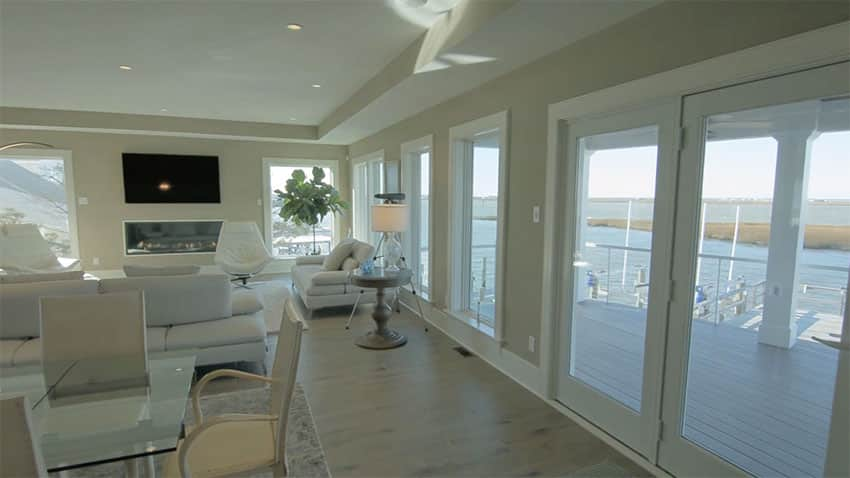 Waterfront bay views from living room with balcony deck
