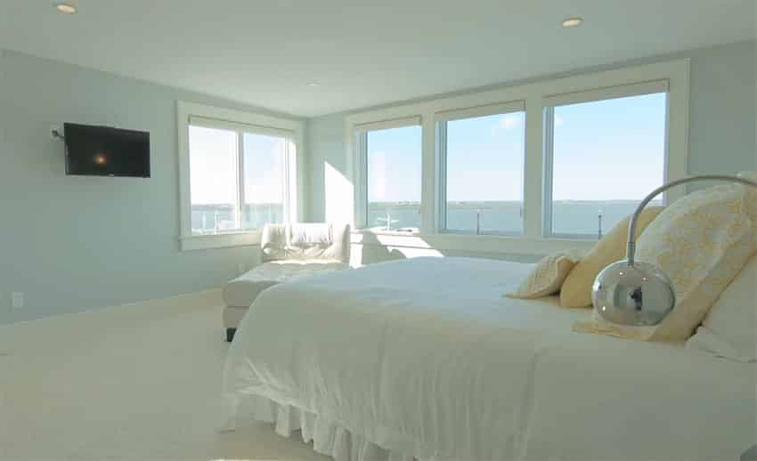 Waterfront view bedroom with light blue paint