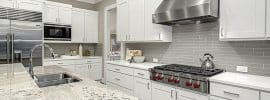 white-cabinet-kitchen-with-gray-ceramic-tile-backsplash