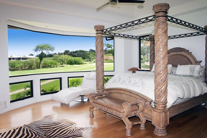 Amazing view from bedroom with decorative four post bed, wood floor and zebra rug