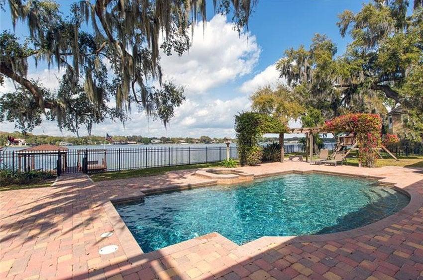 Backyard swimming pool with lake views