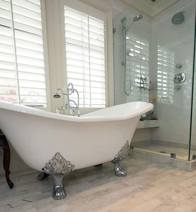 Bathroom with arabella cast iron double slipper clawfoot tub
