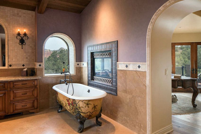 Bathroom with painted clawfoot tub and fireplace