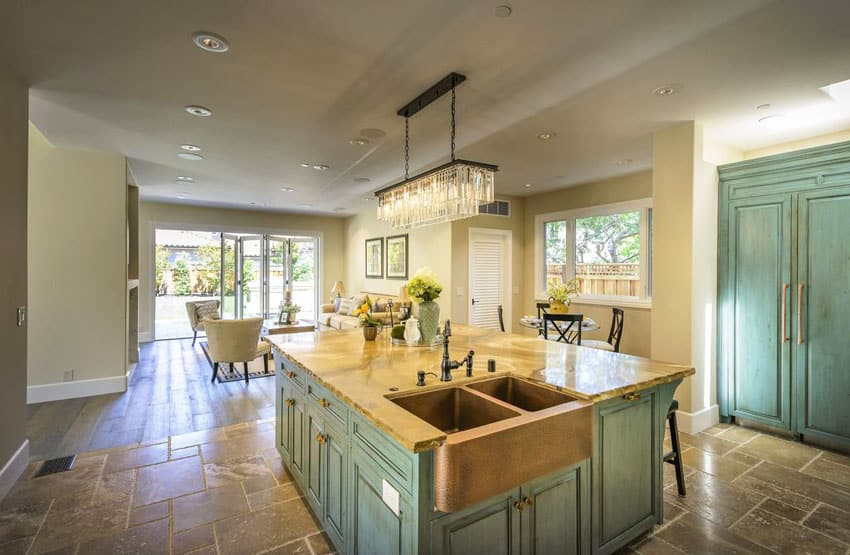Beach style kitchen with green cabinets copper sink and rectangular chandelier