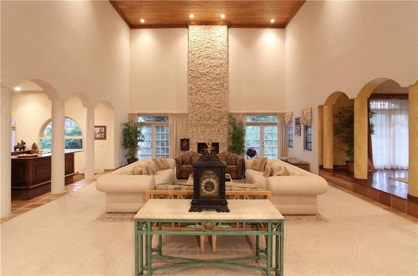 Beautiful living room with stone fireplace and high wood ceiling