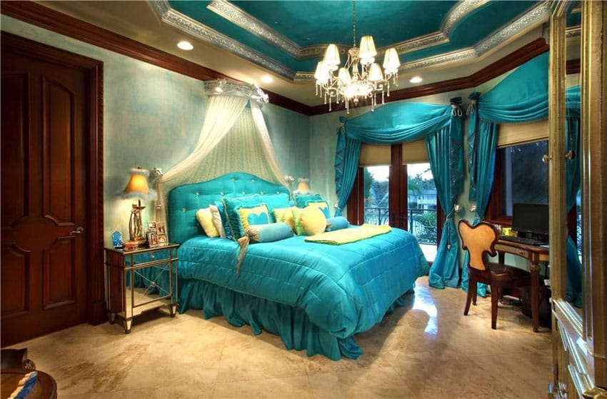 Beautiful blue bedroom with glam decor and furnishings