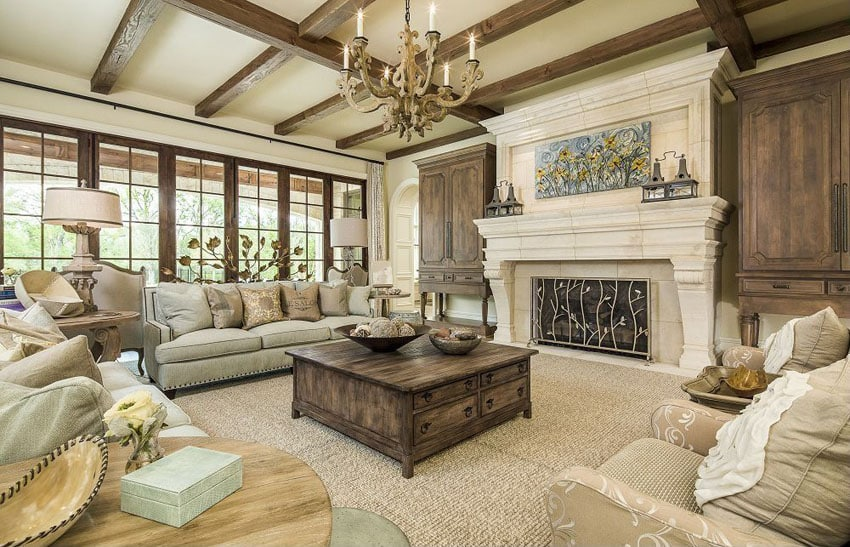 Beautiful craftsman living room with exposed beams and light color stone fireplace