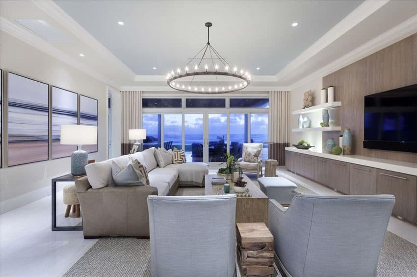 Beautiful large living room with circular light fixture and tray ceiling