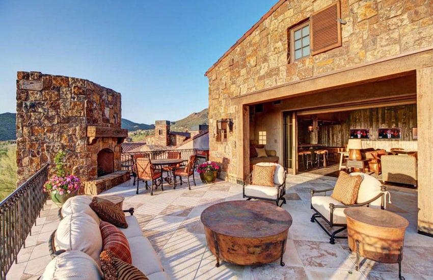 Beautiful southwestern style luxury patio with stone fireplace