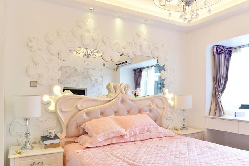 Beautifully decorated bedroom with pink bedding and white bed frame