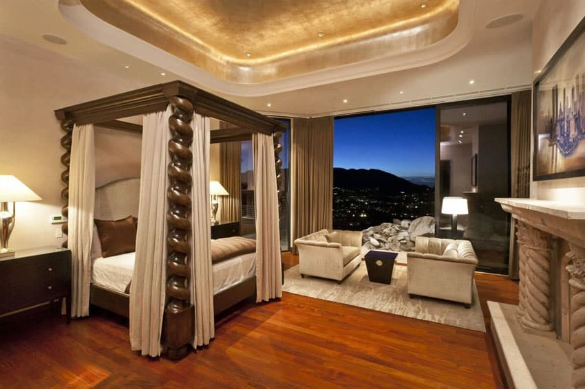Bedroom with custom four post bed Brazilian cherry wood floors and stunning city views