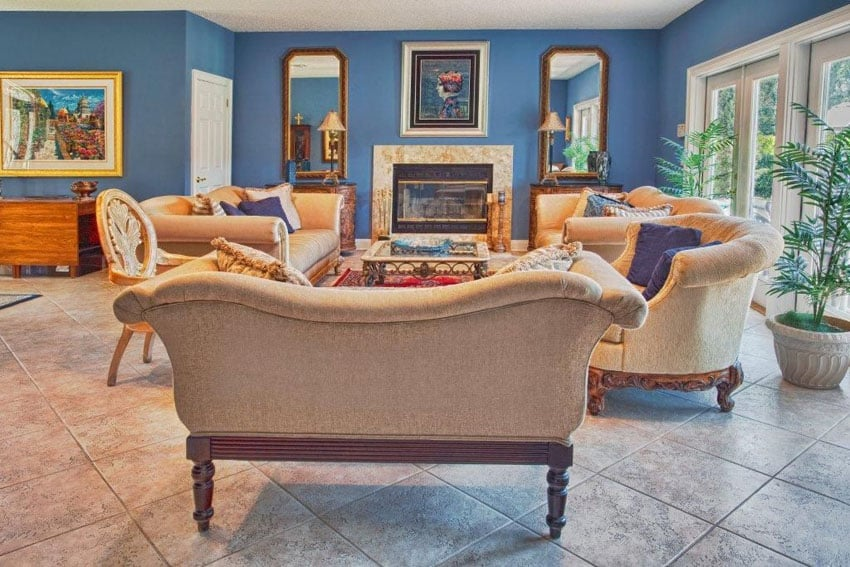 Blue living room with french doors and fireplace