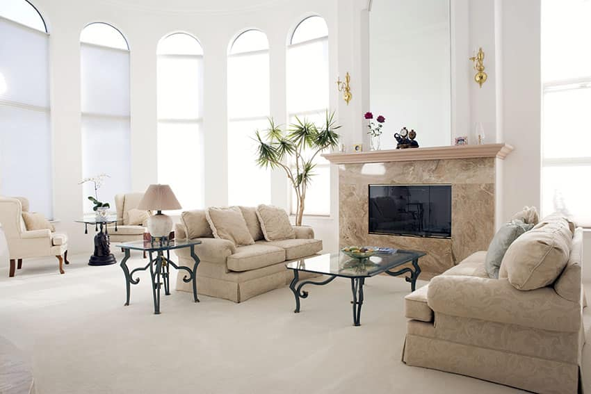 Bright spacious formal living room with high windows and ceiling