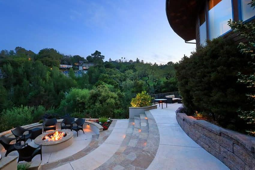 Concrete and stone patio with circular fire pit