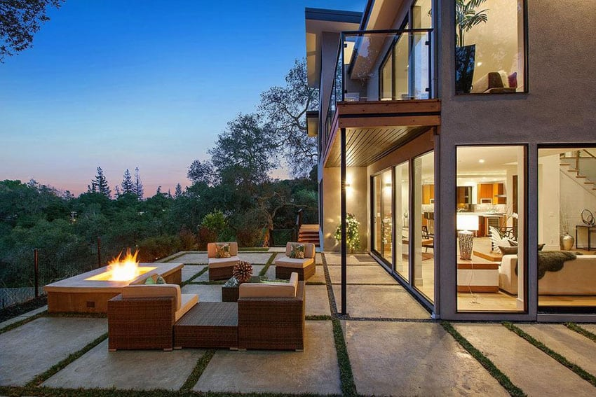 Concrete slab patio with fire pit and hill side views