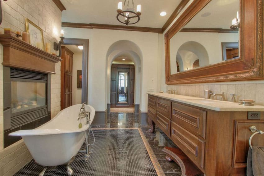 Contemporary bathroom with cast iron clawfoot tub and fireplace