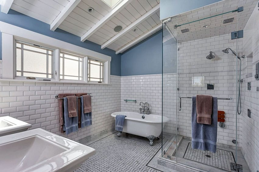 Contemporary bathroom with clawfoot tub with silver feet and white subway tile