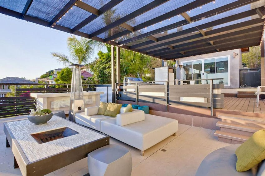 Contemporary covered patio with outdoor lighting