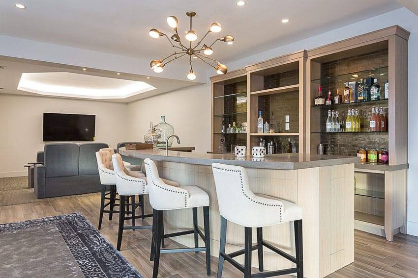 Contemporary custom home bar with hardwood flooring