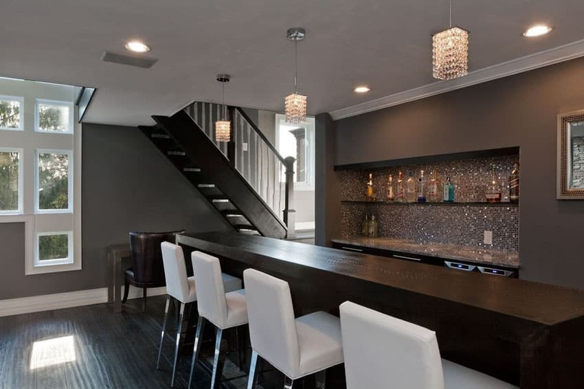 Contemporary home bar with dark wood counter and hardwood floors