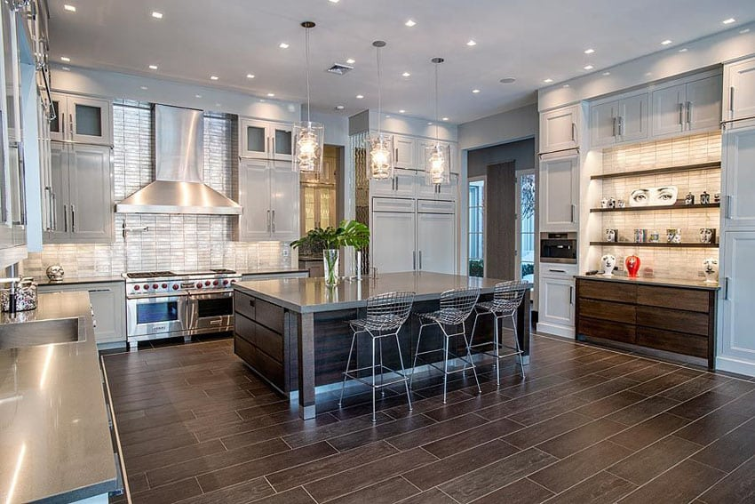 Contemporary kitchen with breakfast bar island and glazed porcelain tile flooring
