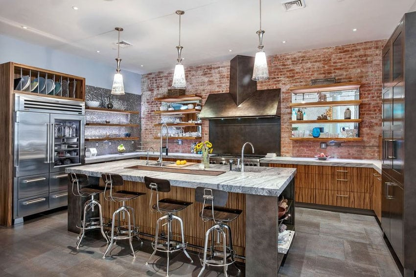 Contemporary kitchen with brick wall and marble countertop island