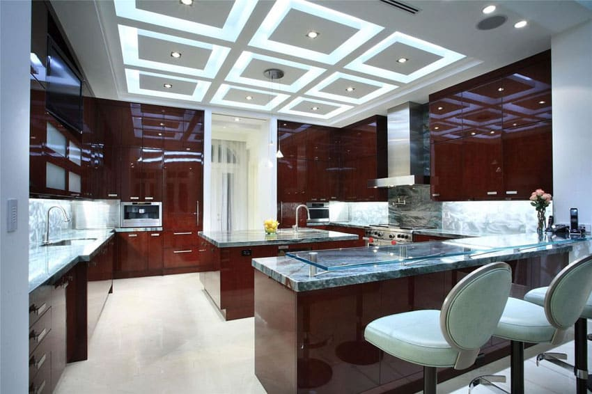 Contemporary kitchen with high sheen dark cabinetry and glass breakfast bar