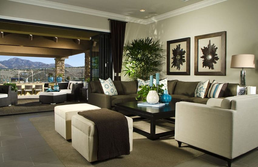 Contemporary living room with brown and cream furniture and retracting sliding door to patio