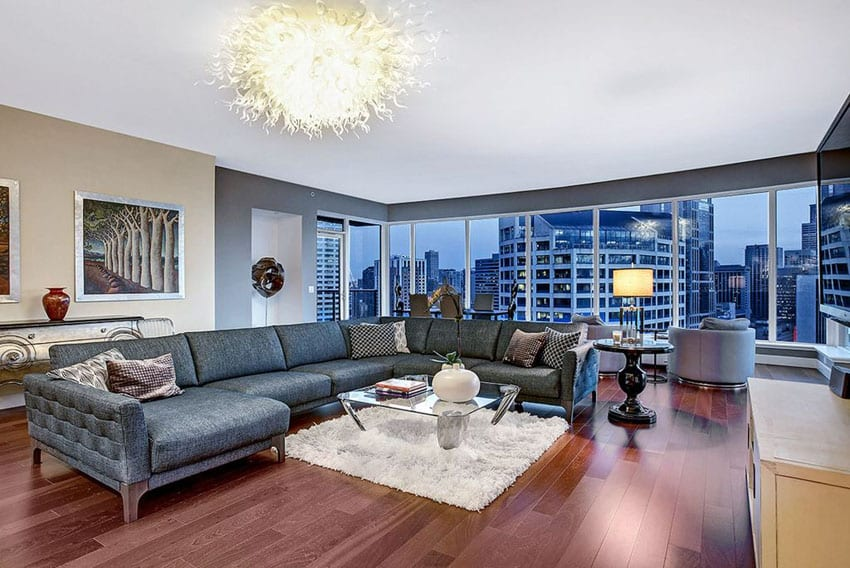 Contemporary living room with chihuly inspired light fixture and city views