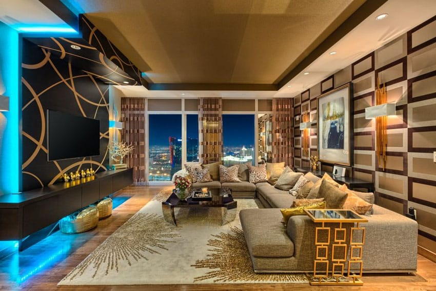 Contemporary living room with neon lighting and brown decor
