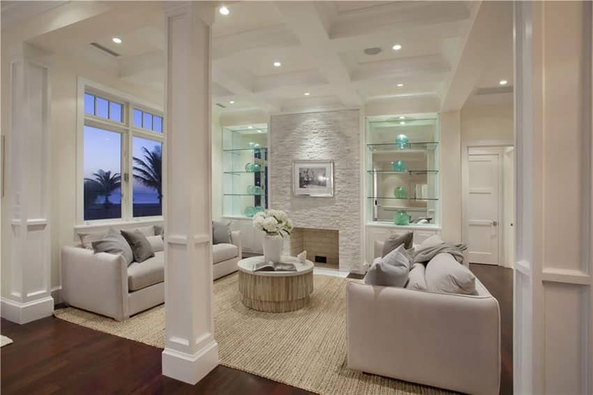 Contemporary living room with oak hardwood floors and built in bookshelves
