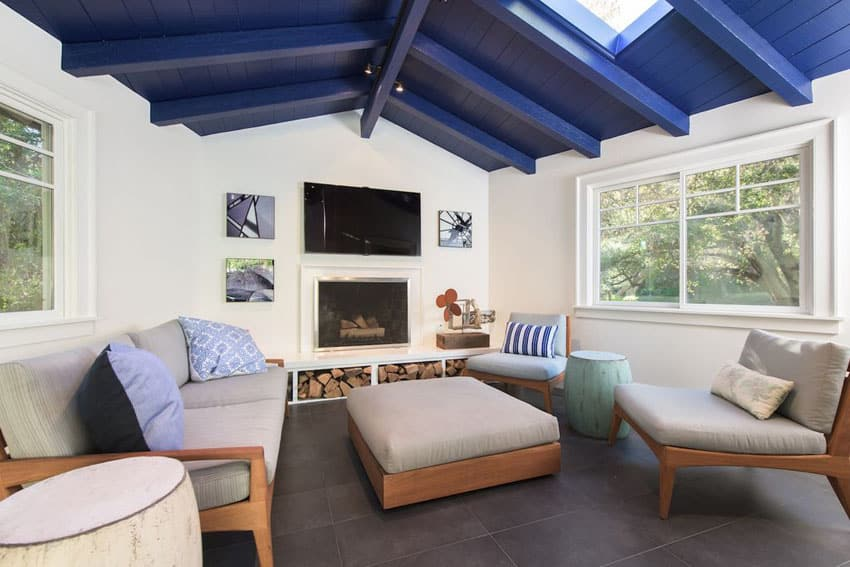 Contemporary living room with painted blue wood plank ceiling